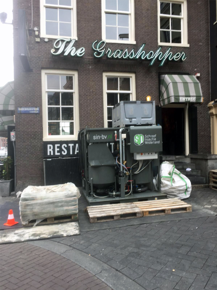 Groutpomp  Oude Brugsteeg te Amsterdam
